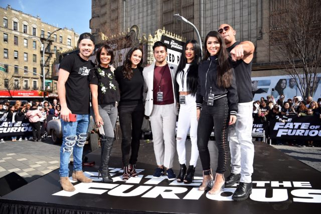 "NEW YORK, NY - APRIL 11: William Valdes, Birmania Rios, Carolina Enamorado, and Sherry Maldonado pose with Michelle Rodriguez and Vin Diesel as they visit Washington Heights on behalf of ""The Fate Of The Furious"" on April 11, 2017 in New York City. (Photo by Kevin Mazur/Getty Images for Universal Pictures)"